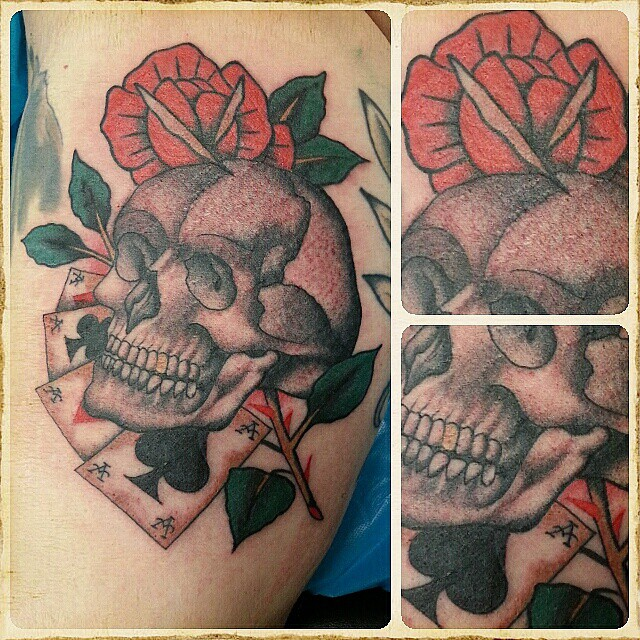 Skull, aces and Rose,  bloody and swollen.  when is healed i will upload a reall